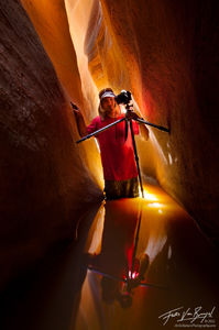 Photographer in Slot Canyon, Zion National Park, Utah, canyoneering,