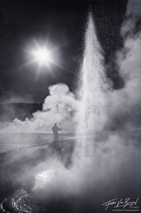 Christmas in Yellowstone, Yellowstone National Park, Wyoming, skier, geyser, erupting, steam